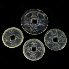A group of four Qing brass commemorative charms