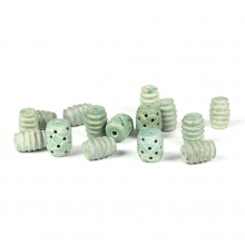 A collection of fifteen (15) carved green stone beads