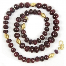 A necklace comprising Indian natural ruby round beads with modern gold elements