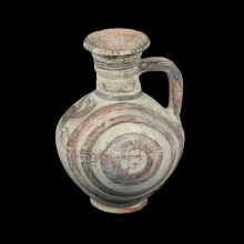 A Cypriot geometrical one handled vessel with two water fowl's