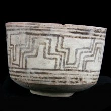 An Indus Valley Mehrgarh buff-ware pottery vessel with painted linear designs