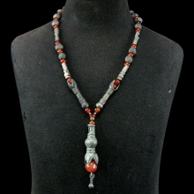 A Mongolian bronze and carnelian bead necklace