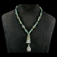 A Mongolian bronze and green stone bead necklace