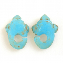 A Pair of Ban Chiang green glass earrings