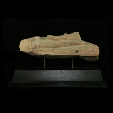 An Ayutthaya sandstone base fragment from a statue off Buddha.