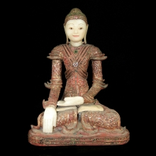 A finely crafted Mandalay alabaster and wooden seated figure of a Buddha.