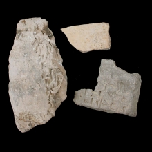 Three fragments from Sumerian clay envelopes, with cuneiform inscription