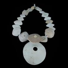 A Bactrian fossilised shell bead necklace.