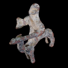 A bronze camel and rider figurine