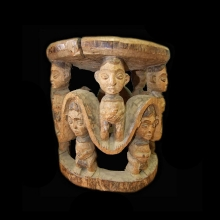 A Cameroon grasslands stool with figural carvings