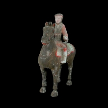 A Chinese Han Dynasty pottery horse with rider