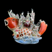 A Chinese porcelain koi with the eight immortals riding on the back
