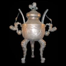 A Chinese silver gilded race trophy, features repousse work, and mythical creatures