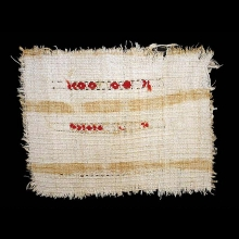 A Coptic flax textile fragment with red dyed woolen embroidery