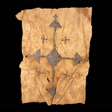 A Coptic linen textile fragment embroidered with christograms in gilded copper sequins