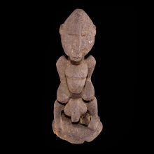 A Dogon wooden male figure with powerful form