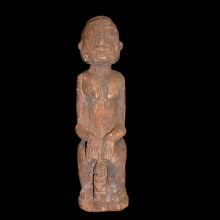 A Dogon wooden seated female figure
