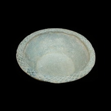 A Gandharan grey schist bowl with elegant incised lotus flower design