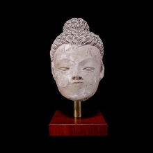 a-gandharan-sunbaked-earthenware-head-of-buddha_08548a