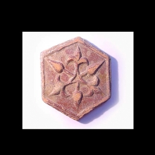 A Ghaznavid reddish-brown glazed ceramic tile, of hexagonal shape.