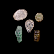 A group of 5 (five) early Islamic glass vessel stamps