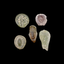 A group of 5 (five) early Islamic glass vessel stamps.