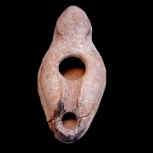 A Holy Land moulded terracotta oil lamp.