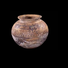 A large and rare Indus Valley painted pottery jar, the upper portion decorated with sequences of zebu bulls, trees, zigzag motif and arcane symbols