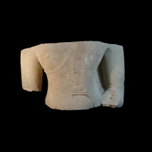 A large Ayutthaya sandstone torso from a statue of Buddha.