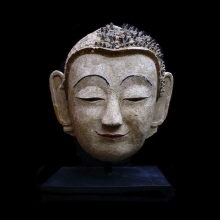 A large Northern Thai Stucco head of Buddha.