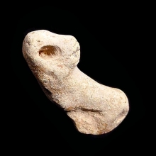 A Near Eastern fragmentary clay figurine of an animal