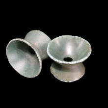 A pair of Dong Son bronze spool-shaped ear ornaments.