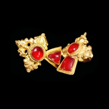 a-pair-of-majapahit-gold-ear-ornaments-set-with-garnets_x141c