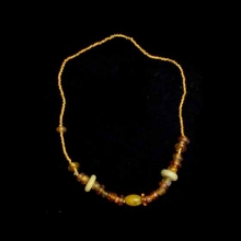 A Roman and Islamic glass and glass paste bead necklace.