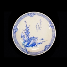 A set of two Japanese blue and white ceramic plates.