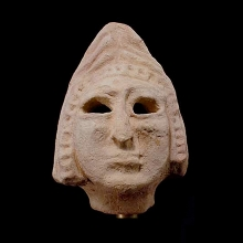 A Sumerian hollow terracotta head of a deity