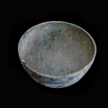 a-western-asiatic-bronze-vessel-of-deep-form-and-decorated-with-stamped-motif_06203b
