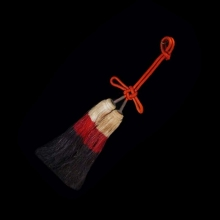 Agemaki knot, red silk cord and fiber tassels; worn as an ornament on armour of a Japanese brigandine.