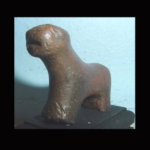 An Amlash solid cast figure of a quadruped; reddish patina.