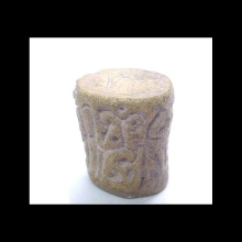 an-ancient-indian-baked-clay-cylinder-seal-with-scrolling-designs.--very-minor-ancient-loss,-otherwise-intact_06106b