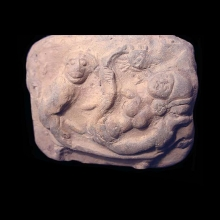 An ancient Indian clay plaque showing an erotic scene with female and monkey