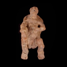 An ancient Sub-Saharan terracotta figure of a woman giving birth