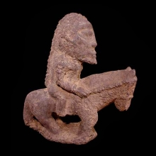 An archaic Dogon red sandstone equestrian figure