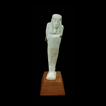 an-egyptian-pale-green-glazed-faience-ushabti_x8616a