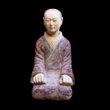 An important Han Dynasty Terracotta Figure of a Stable Master
