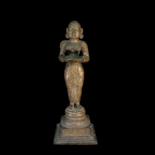 An Indian solid bronze cast oil lamp in the form of the goddess Lakshmi