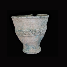 An Indo-Iranian bronze cup with flared rim.