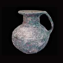 An Indo-Iranian bronze vessel with handle.
