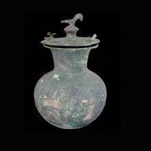 An Indo-Iranian bronze vessel with rope design decoration at mid-section; lid with bird figurines
