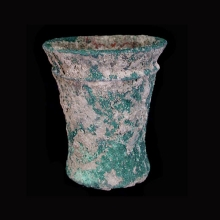 An Indo-Iranian miniature bronze beaker with flared rim.